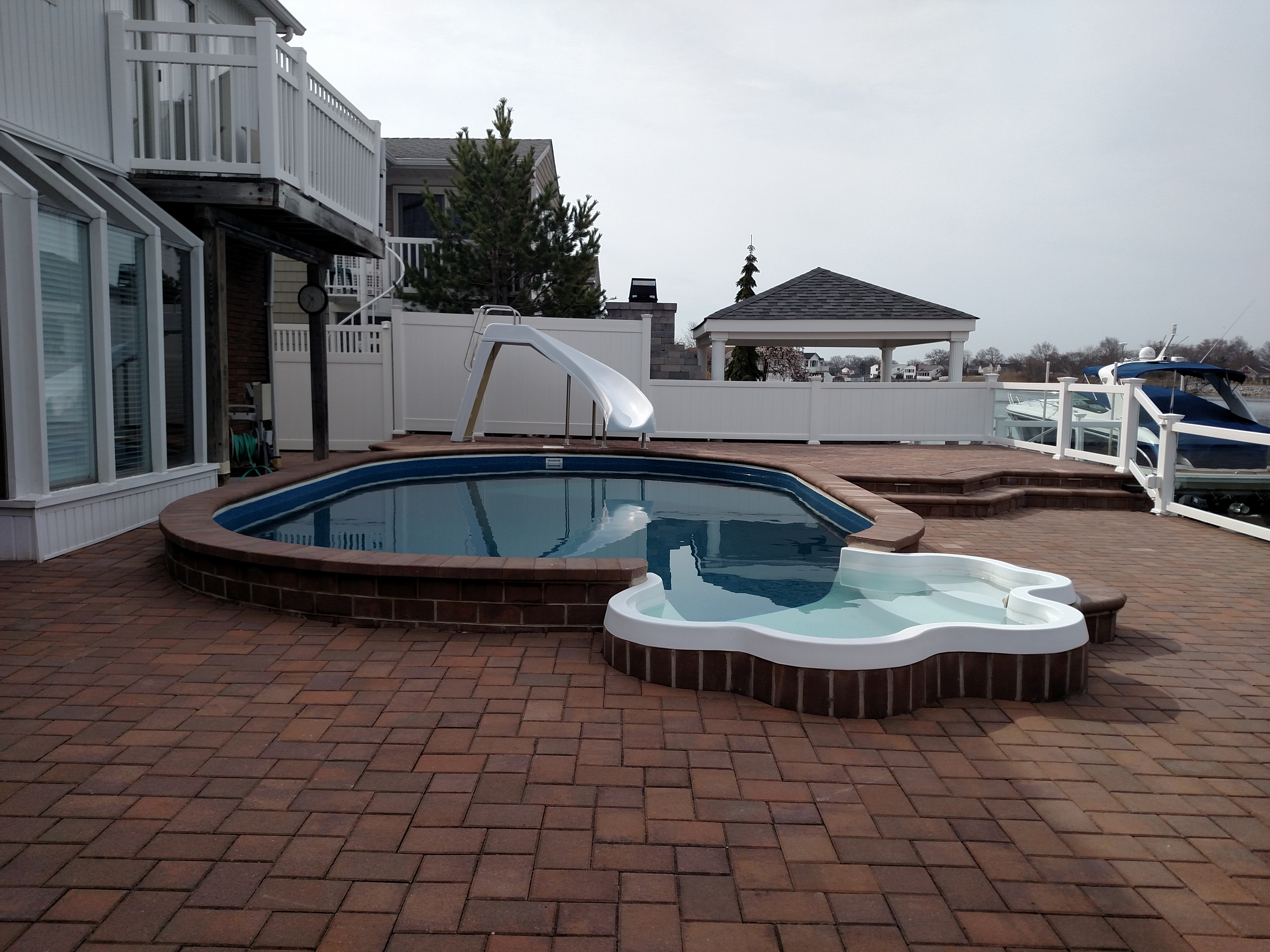 Ideas semi inground pool ideas for exciting backyard for Above ground pool decks tulsa